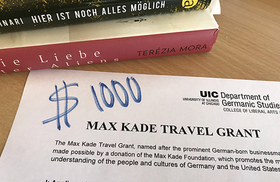 A stack of German books and the application for the Max Kade Travel Grant